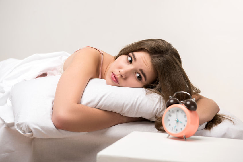 35244939 - beauty lying on the bed with a clock
